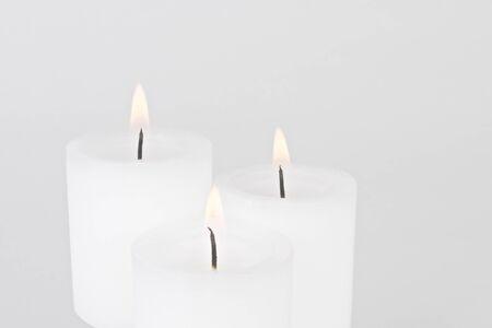 Three Burning White Candles