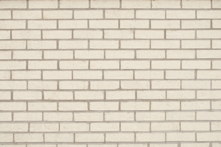 Light Tan Brick Wall as a Background Stock Photo
