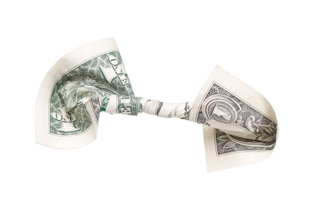 A United States One Dollar Bill that has been Twisted Around Itself Stock Photo