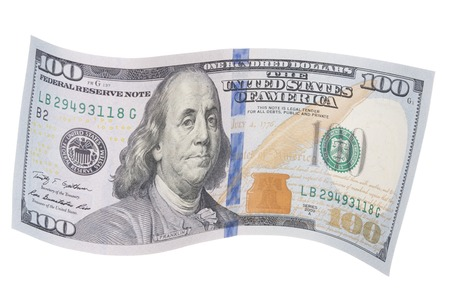 New United States One Hundred Dollar Bill in a Wavy Shape Stock Photo