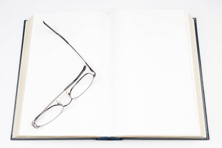 Open Hardcover Book with Blank Pages and Reading Glasses