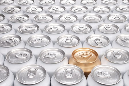 One Gold Can Among a Group of Aluminum Beverage Cans