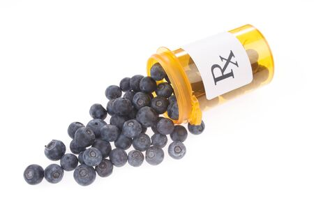 Prescription Bottle Filled with Fresh Blueberries