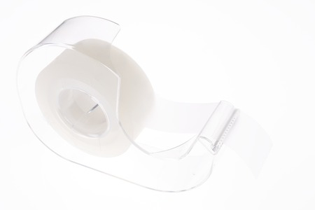 Invisible Tape and Clear Plastic Dispenser on a White Background