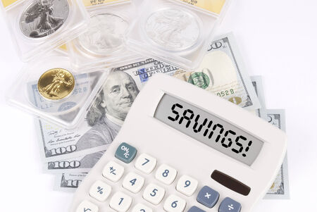 Graded Coins and Currency with Calculator that says SAVINGS