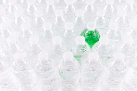 Staggered Group of Plastic Water Bottles with Green Liquid in One Stock Photo
