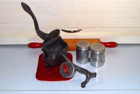 utencils: Antique juicer and utensils