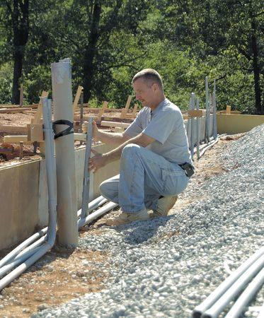 Electricista ortesis de tuber�as subterr�neas para, por debajo de la losa  Foto de archivo - 2005463