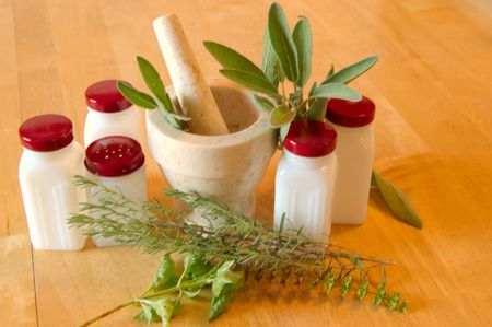 herbs , spice jars and mortar , pestle