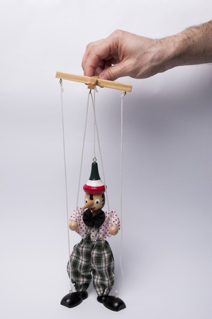 animal related: Man who puлls the strings Stock Photo