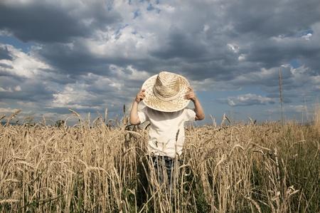 Boy in a whet field