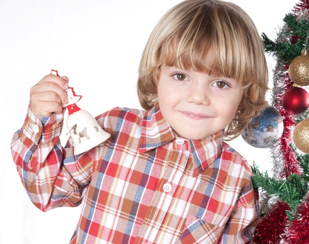 Blond boy with Santa hat and a bell Stock Photo