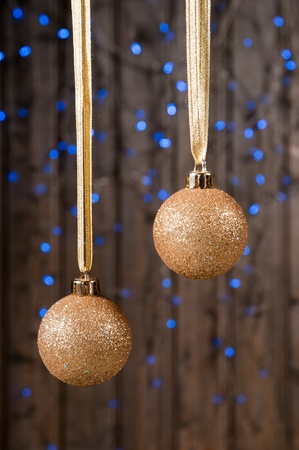 bolls: Two gold bolls infront old wood background