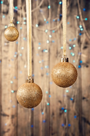 bolls: Tree gold bolls infront old wood background