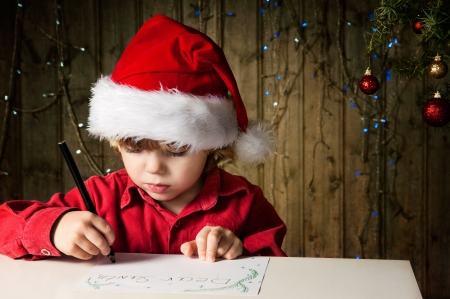 Blond boy writes a letter to Santa photo