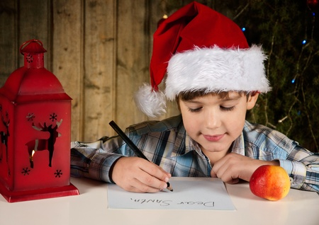 A boy writes a letter to Santa photo