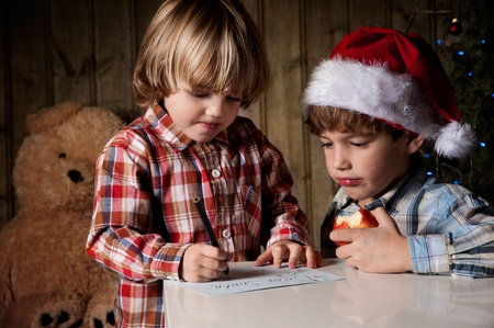 Two boys write a letter to Santa Stock Photo