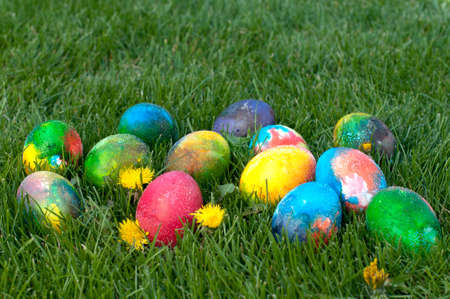 Easter eggs on the grass- selective fokus ot the red egg photo