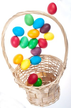 Easter eggs flying from basket photo