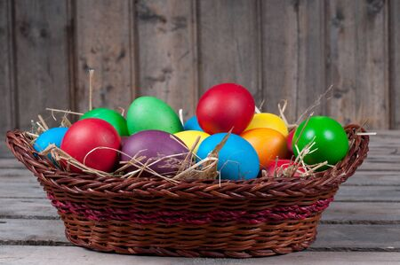 Easter eggs in  brown pannie on the wooden floor Stock Photo - 11941725