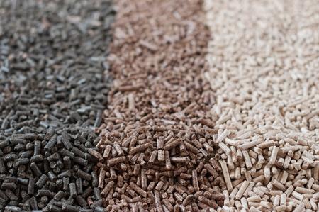 Different kind of pellets- sunflower,pine,beech, Stock Photo