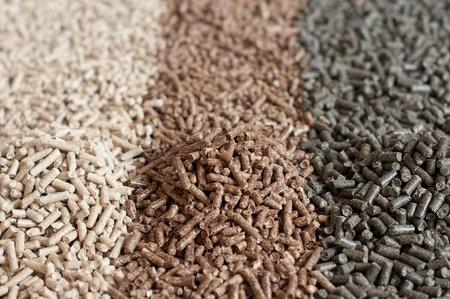 pellet gun: Different kind of pellets - pine,beech,sunflower- selective focus on the heap