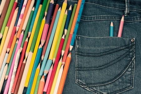 Different kind of pencils on the jeans texture photo