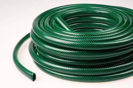 Green hose on a white background
