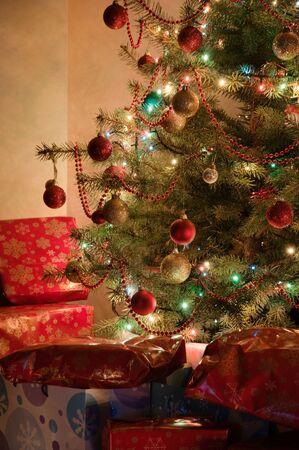Illuminated Christmas tree at night with presents Stock Photo - 15516387