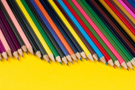 Colored pencils arranged in a row photo