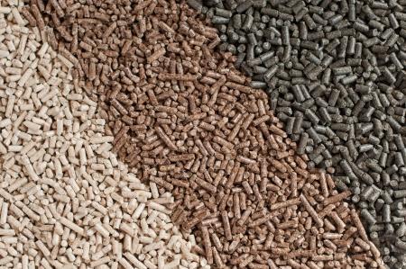 biomasse: Three  kind of pellets in a row