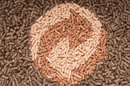 Three types of pellets forming the sign of recycling