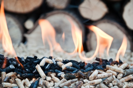 biomasse: Pellets in flames- stock photo Stock Photo