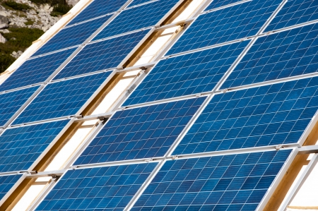 viewfinderchallenge3: Power plant using renewable solar energy with sun on a roof- stock photo