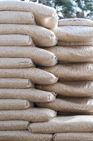 pellet gun: Pine pellets- stack of sacks- stock photo