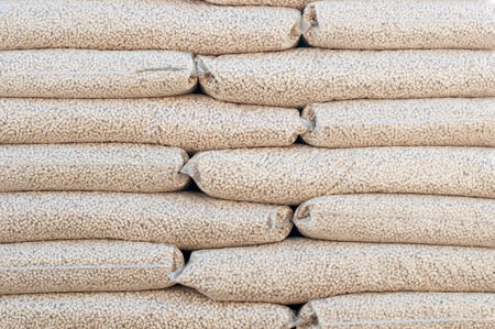 wood pellet: Heap of stacks of Pine pellets - stock image Stock Photo