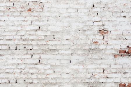 Part of old white brick wall
