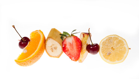 Different kind of fruits on a skewer photo