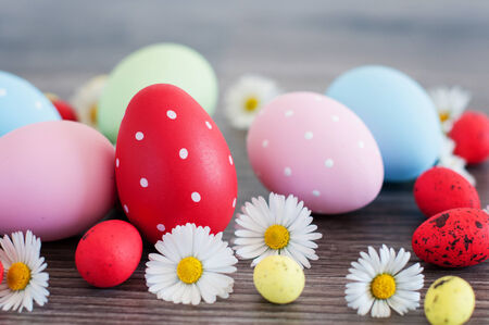 Different color Easter egg on an old wood