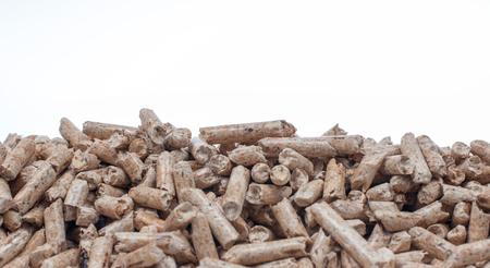 biomasse: Biomass- pine pellets on a white background