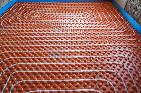 Underfloor heating sistem- pipes, instalation, orange base photo