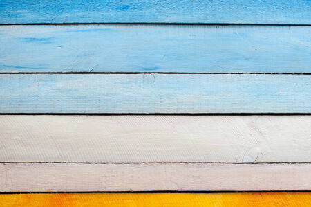 yeloow: Part of old blue white yeloow wooden wall