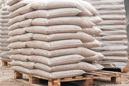 pellet gun: Pile of sacks of pellets, which are stacked on pallets Stock Photo