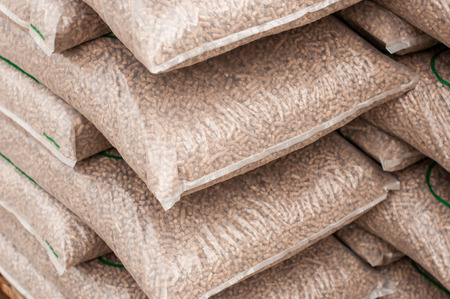 wood pellet: Pile of sacks of pellets, which are stacked on pallets Stock Photo
