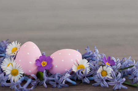 Two pink Easter eggs with spring flowes