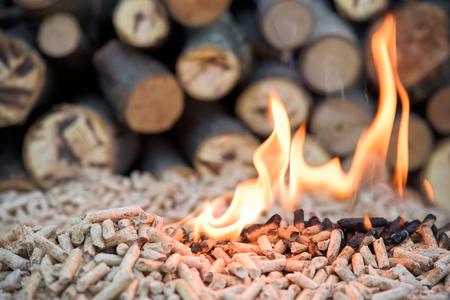 granule: Fir biomass in flomes - renewable energy Stock Photo
