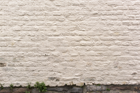 Part of old white brick wall - stone bottomn Stok Fotoğraf