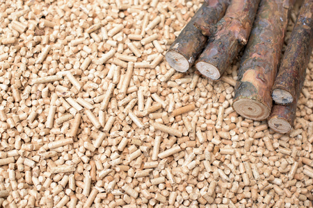 Coniferous biomass - wood and pellets, renewable energy Stock Photo