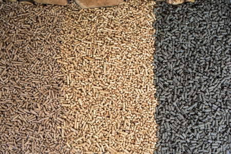 Three different kind of wooden pellets- pine, oak, sunflower pellets