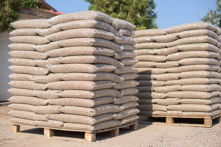 Many sacks that are filled with pellets placed on pallets